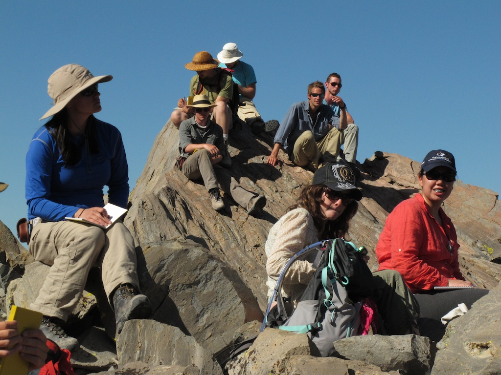 On a mountain called Obsidian Dome listening to a lecture on how obsidian forms. Photo by Mike Young.